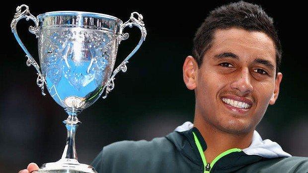 Nick Kyrgios holding Australian Open Junior Trophy 2013